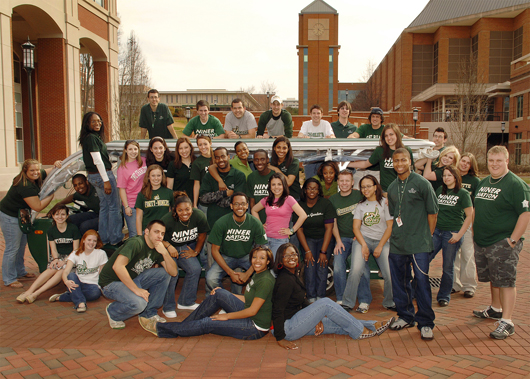 Students behind UNC Charlotte's Halton Arena.